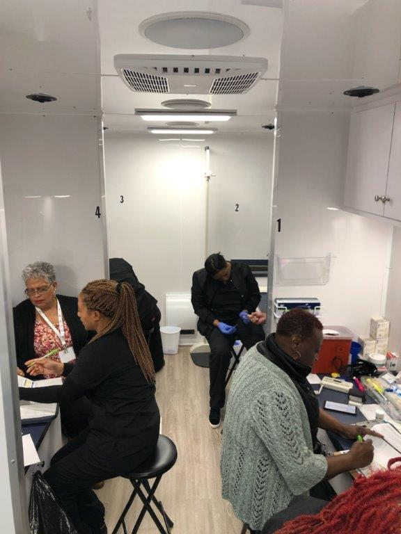 4 exam stations inside health screening trailer